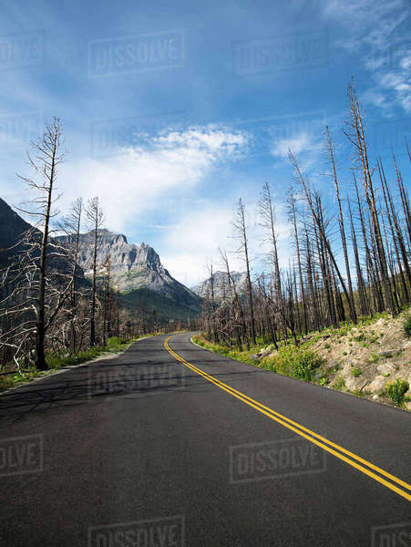 Empty country road against sky on sunny day Royalty-free stock photo