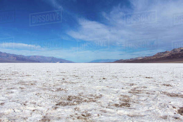 Scenic view of snowy field against blue sky Royalty-free stock photo