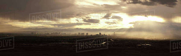 Panoramic view of cityscape against cloudy sky during sunset Royalty-free stock photo
