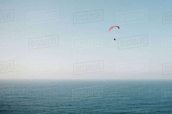 Person paragliding over sea Royalty-free stock photo