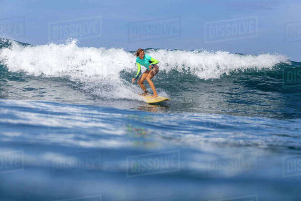 Woman surfing in sea against sky on sunny day Royalty-free stock photo