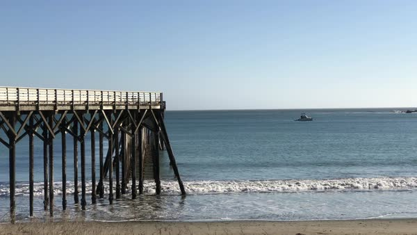 Static shot of pier in the afternoon with sea behind it. Royalty-free stock video