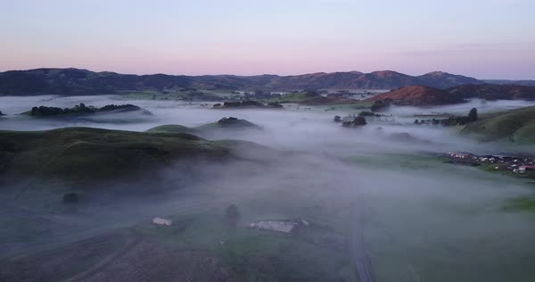 Drone shot of hills of Petaluma covered in mist Royalty-free stock video