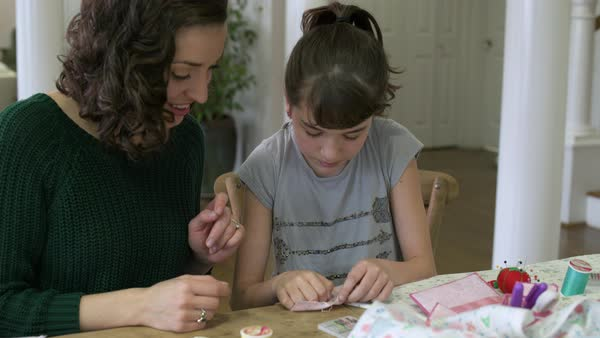 Mother teaching her daughter how to sew Royalty-free stock video