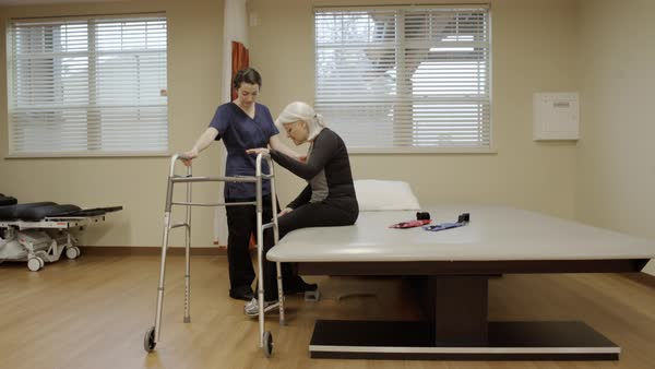 Full shot of a senior woman using a walker Royalty-free stock video