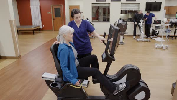 Medium shot of a senior woman using a rehabilitation bicycle Royalty-free stock video