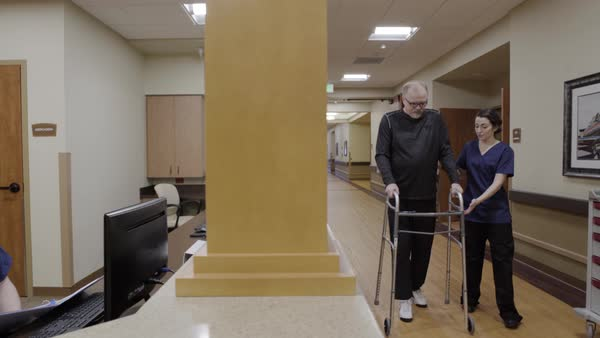 Panning shot of a senior man using a walker Royalty-free stock video