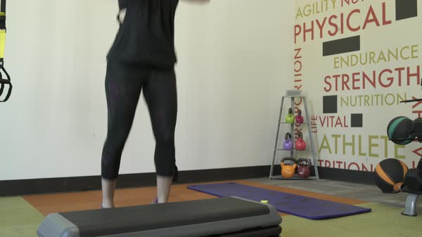 Jib shot of a woman doing jumps in a gym Royalty-free stock video