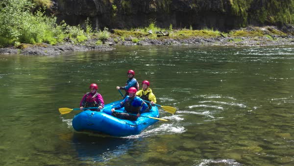 Full shot of four people rafting on a river Royalty-free stock video