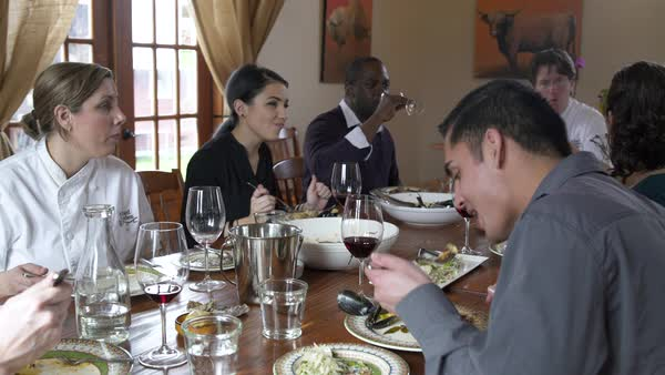 Chefs and students having a meal together Royalty-free stock video