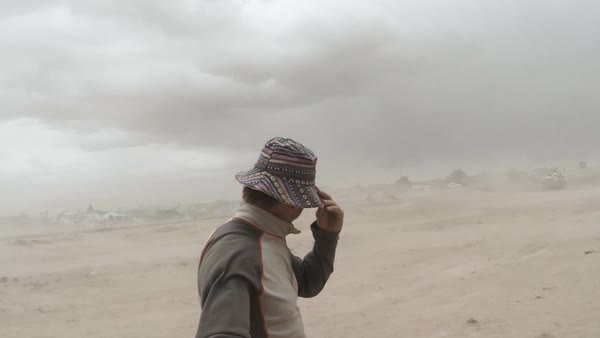 Selfie shot of a man standing in a sand storm Royalty-free stock video