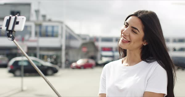 Woman taking a selfie with a selfie stick Royalty-free stock video