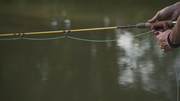 Slow motion shot of a man fly fishing in a lake Royalty-free stock video