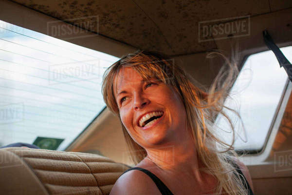 Sweden, Blonde woman laughing on back seat of car Royalty-free stock photo