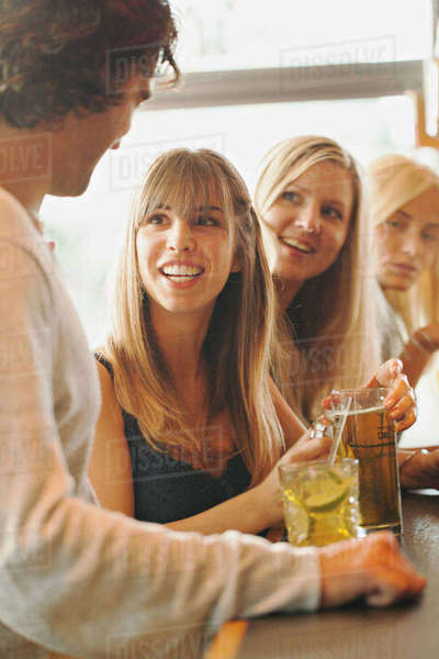 Sweden, Man talking with women in bar Royalty-free stock photo