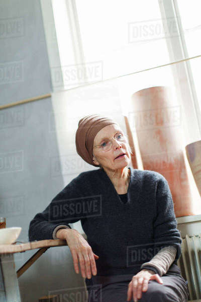 Sweden, Senior woman in headscarf and eyeglasses smiling Royalty-free stock photo