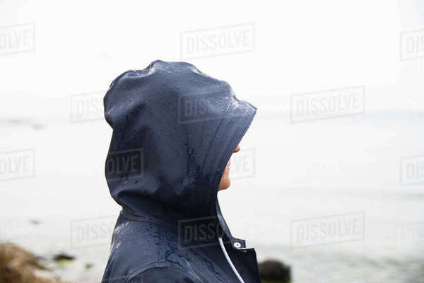 Sweden, Gotland, Mature woman in hood at beach Royalty-free stock photo