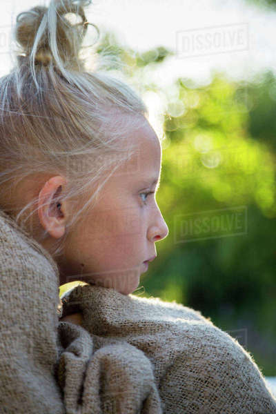 Sweden, Portrait of pensive girl (12-13) wrapped in blanket Royalty-free stock photo