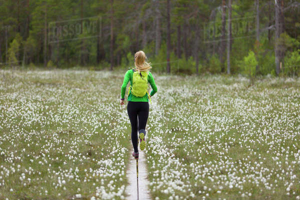 Sweden, Vasterbotten, Grossjons Nature Reserve, Woman running on footpath Royalty-free stock photo