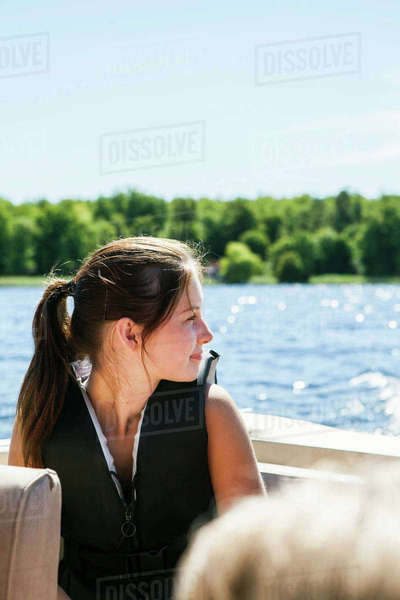 Sweden, Skane, Bromolla, Profile of teenage girl (16-17) against lake in sunlight Royalty-free stock photo