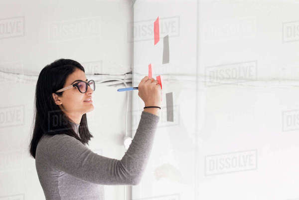 Israel, Woman writing on adhesive notes Royalty-free stock photo