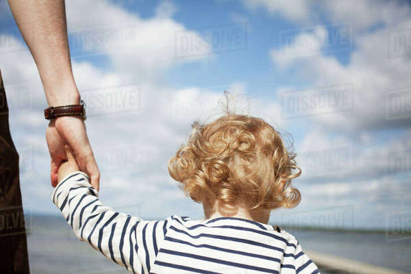 Sweden, Skane, Man holding his daughter�s (2-3) hand Royalty-free stock photo