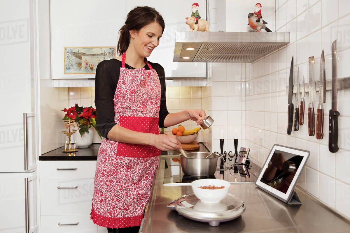 sweden woman cooking in kitchen stock photo dissolve