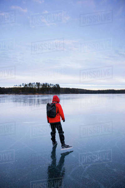 Sweden, Dalarna, Lintjarnen, Woman ice skating on frozen lake Royalty-free stock photo