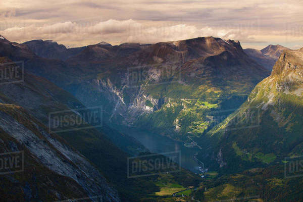 Norway, More og Romsdal, Sunnmore, Geirangerfjord, Narrow patch of sea at bottom of fjord in evening Royalty-free stock photo