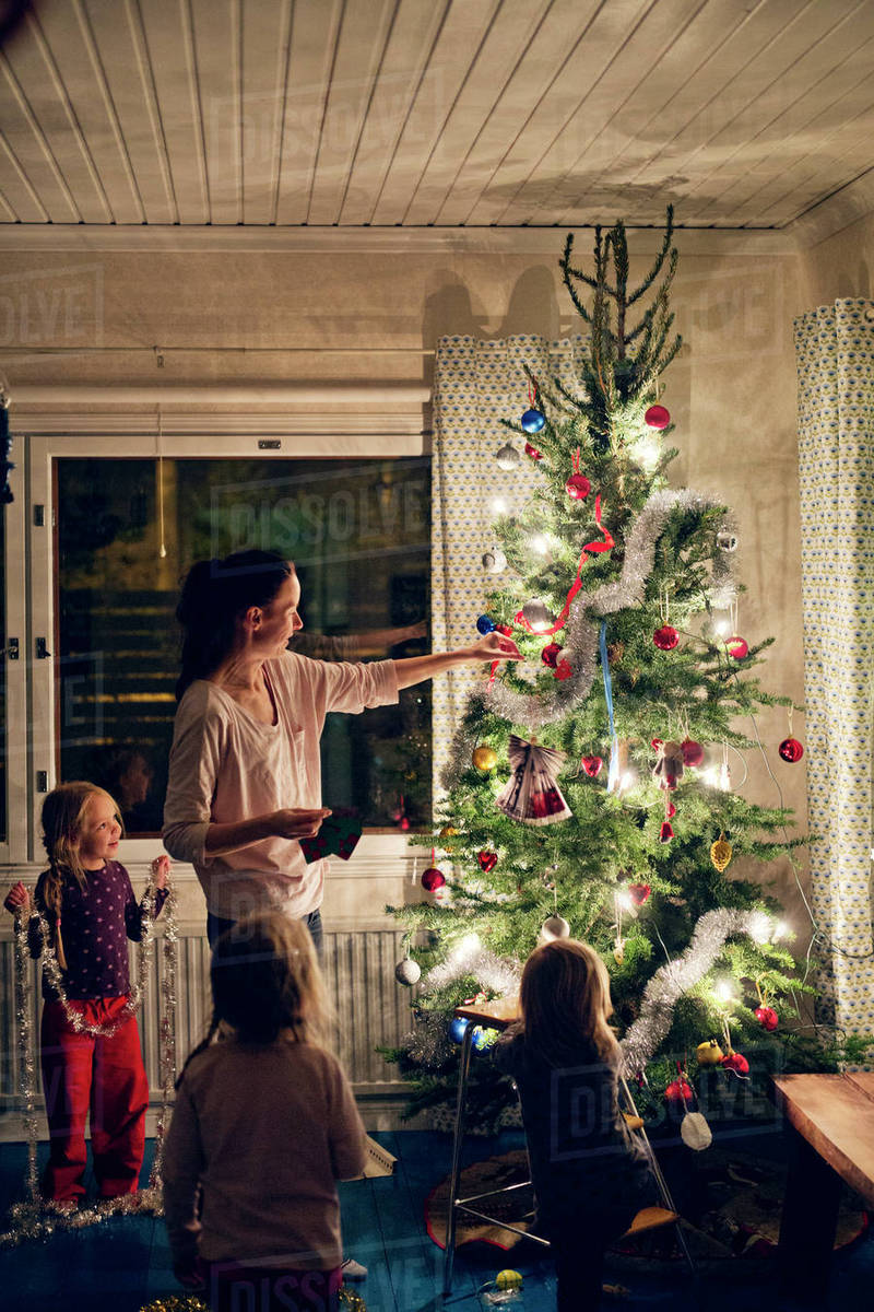 Finland Christmas Decorations.Finland Mother With Daughters 12 17 Months 2 3 4 5 Decorating Christmas Tree Stock Photo