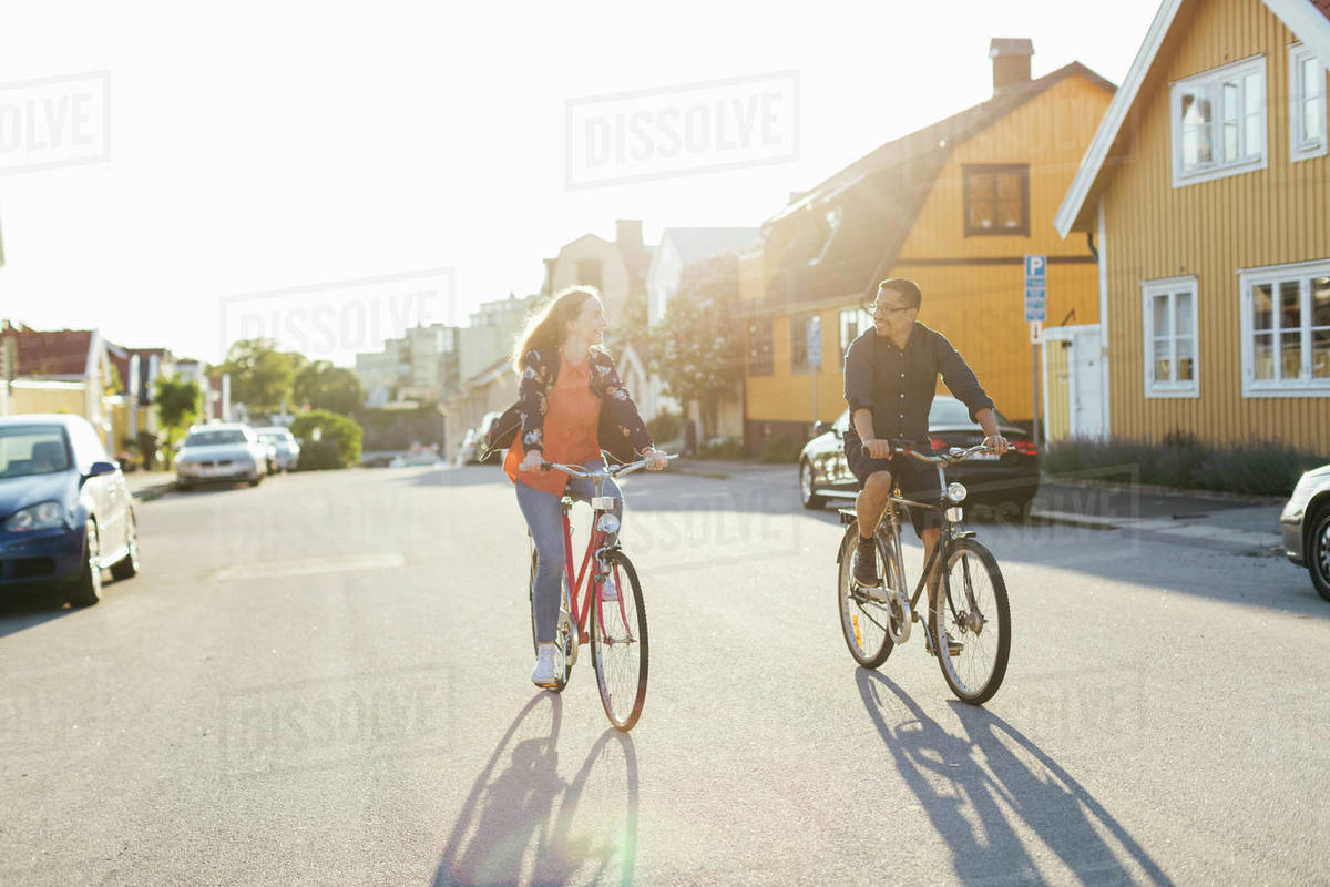Couple cycling on suburban street Royalty-free stock photo