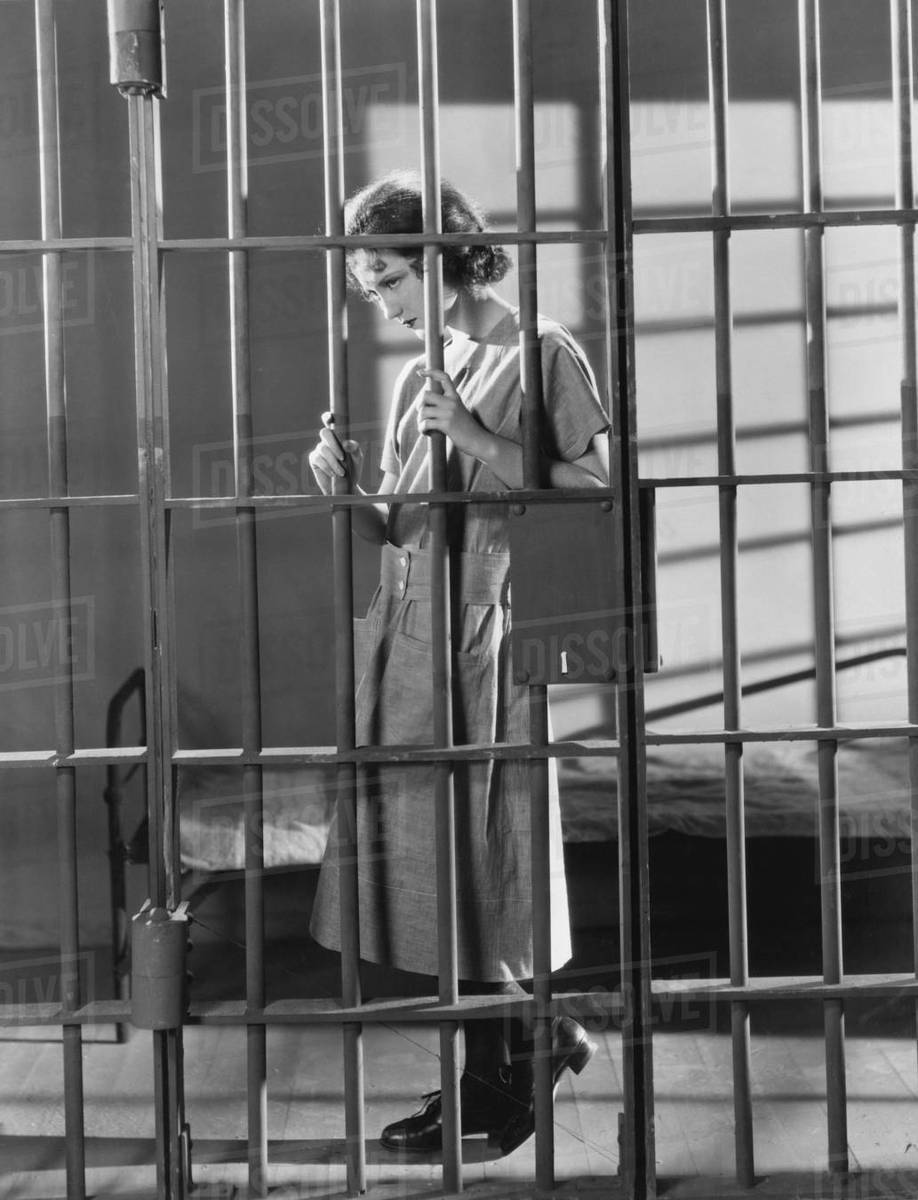 woman in jail cell stock photo dissolve