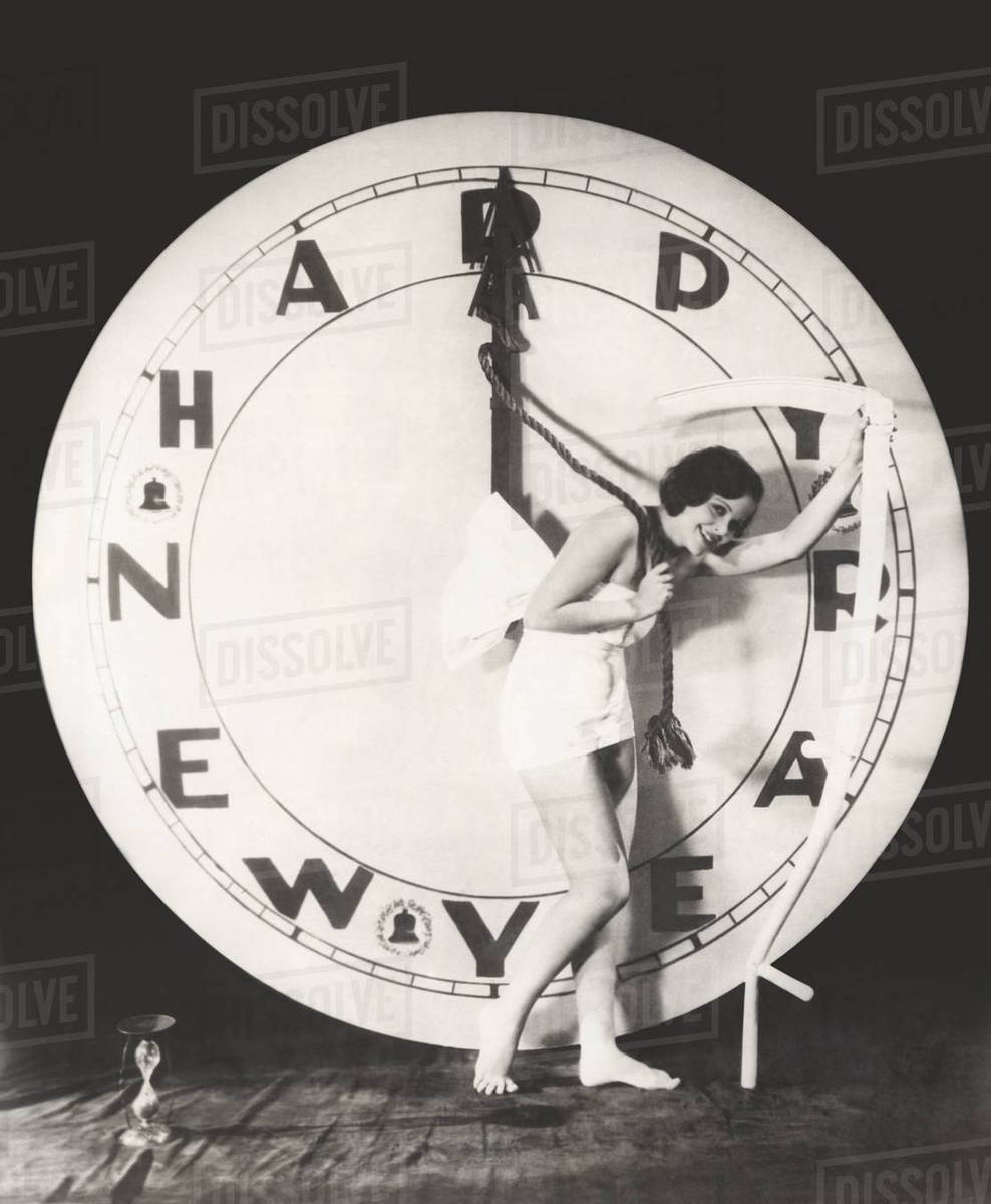 Woman pulling the hour hand of giant clock on New Year\'s Eve - Stock ...