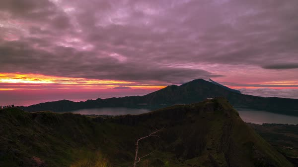 Timelapse. Sunrise on the volcano Batur overlooking Lake Batur Royalty-free stock video