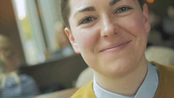 Hand-held shot of a genderqueer person smiling at camera Royalty-free stock video