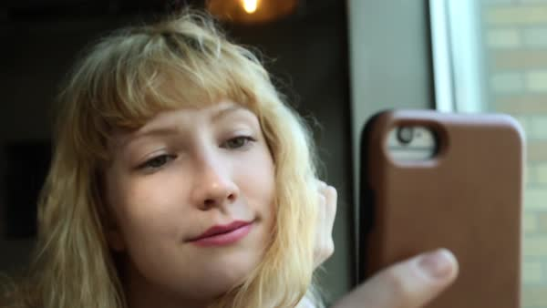 Hand-held shot of a young woman taking a selfie Royalty-free stock video