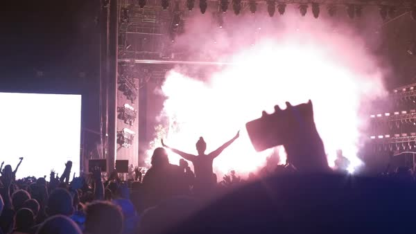 Slow motion shot of a crowd watching a concert with pyrotechnics Royalty-free stock video
