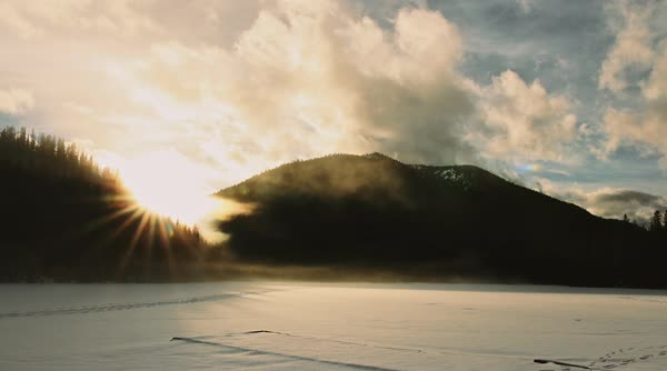 Timelapse of mist drifting across a frozen lake Royalty-free stock video