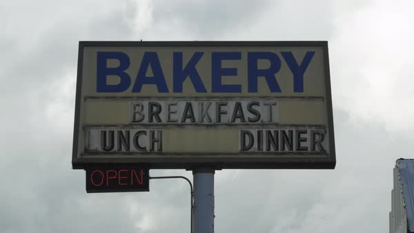 Hand-held shot of sign of a bakery cafe Royalty-free stock video