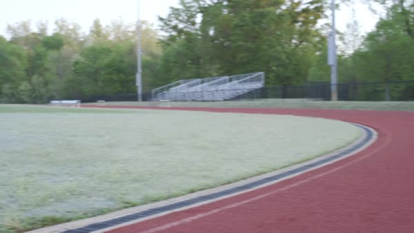 Dolly shot of a man sprinting on an outdoor track Royalty-free stock video