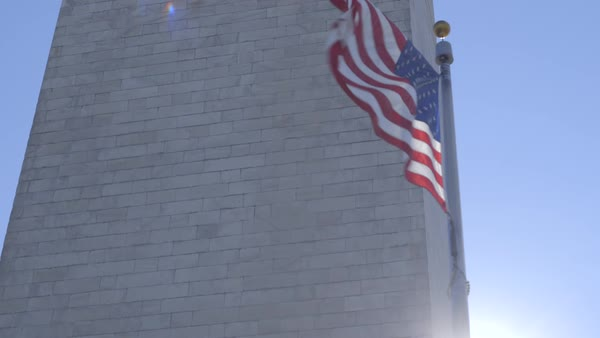 Dolly shot of an American flag flapping in wind Royalty-free stock video