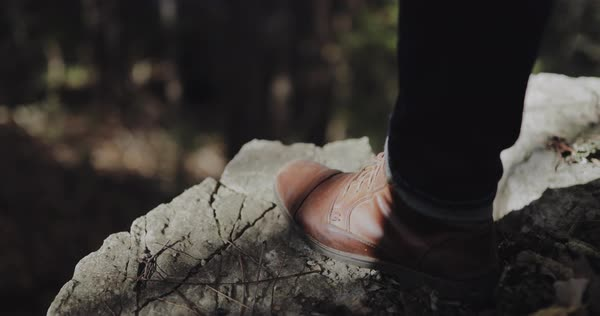 Hand-held shot of a person stepping on a rock Royalty-free stock video