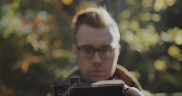 Hand-held shot of a photographer with a vintage camera Royalty-free stock video