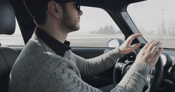 Slow motion shot of an happy driver during road trip Royalty-free stock video