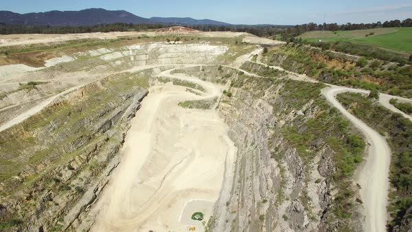 Aerial rise with camera tilt revealing old limestone quarry