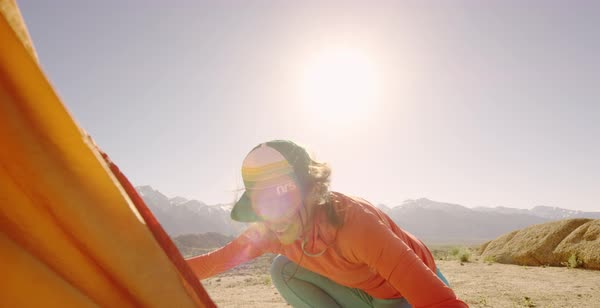 Slow motion shot of two female hikers setting up a tent in Alabama Hills Royalty-free stock video