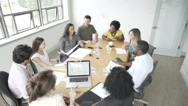 Hand-held shot view of a group of business people in a meeting Royalty-free stock video