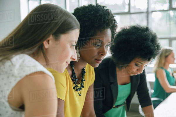 Three businesswomen working together in an office Royalty-free stock photo