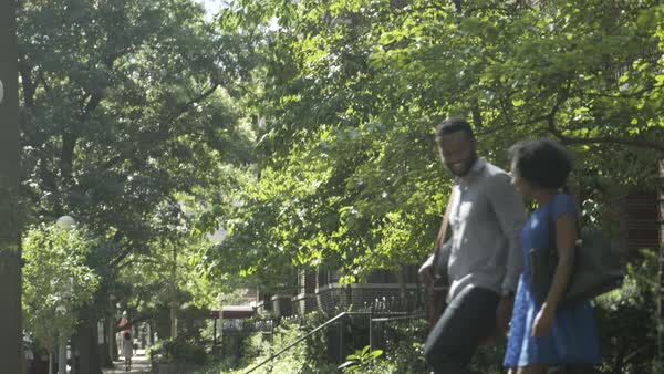 Gimbal shot of a man and a woman walking down front steps of a house Royalty-free stock video