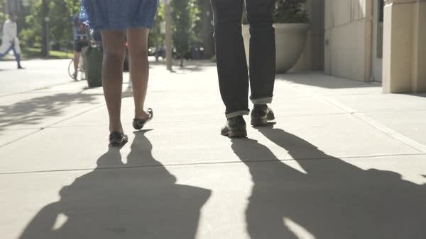 Tracking shot of a man and a woman walking on a street together Royalty-free stock video